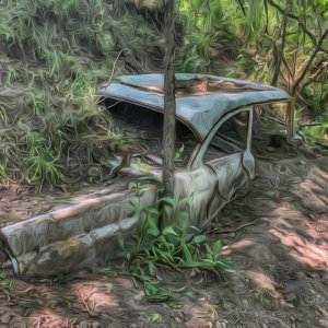 Old Car Buried In The Hillside